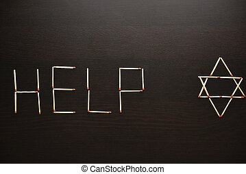 Help with magen David, Israel word from matches. Word help magen David, Israel from matches on a black wood. Concept of matches, the inscription Help with magen David, Israel.