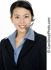 Helpdesk - A young attractive woman wearing a headset on...