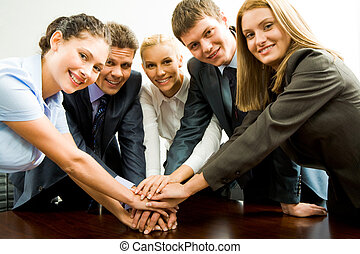 Helpful co-workers - Portrait of happy business team keeping...