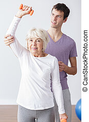 Helpful physical therapist - Helpful young physical...