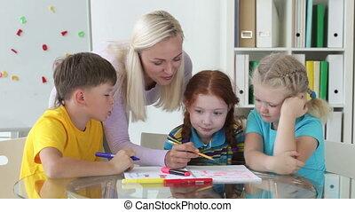 Helpful teacher - Lovely tutor helping her pupils to achieve...