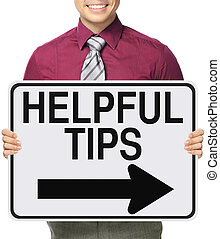 Helpful Tips - A man holding a modified one way sign...