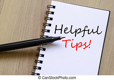 Helpful Tips Concept - White notepad and ink pen on the...