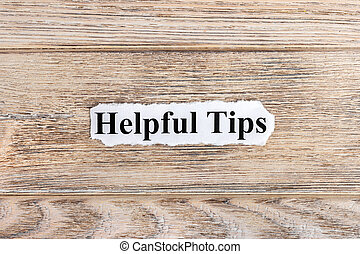 Helpful Tips text on paper. Word Helpful Tips on torn paper. Concept Image