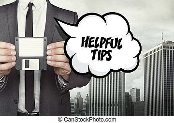 Helpful tips text on speech bubble with businessman holding...