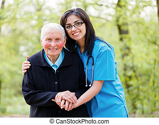 Helping Elderly Peoplee - Portrait of caring nurse helping ...