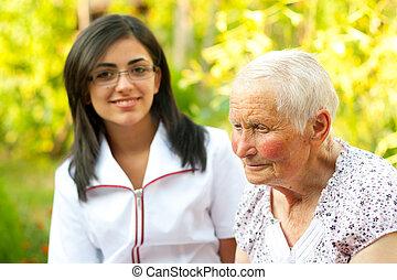 Helping elderly woman