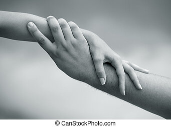 Helping hand - Man's and female hand on a background of the ...