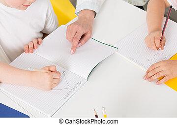 Helping hand of an experienced teacher