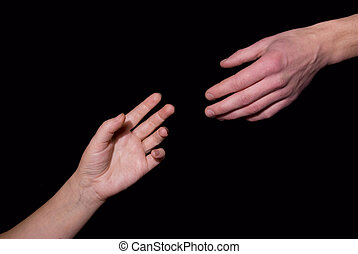Helping hand on black background