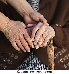 Helping hands - Closeup of caring woman holding female...
