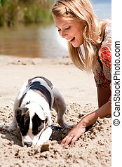 Helping my dog with digging - Blond girl and a american...