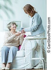 Helping old and ill mother - Daughter is helping her old and...