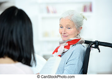 Helping senior woman to read