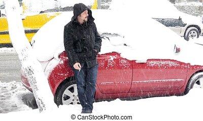 Helpless man waiting rescue, Car stuck under snow, snowy day...