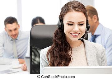 helpline operator with headphones in call centre - business,...