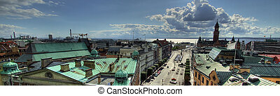 A high dynamic range panoramic image of the Helsingborg city centre with Denmark in the distance.