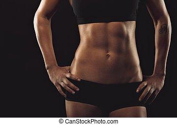 hembra, con, perfecto, abdomen, músculos