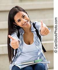 hembra, estudiante de la universidad, con, pulgares arriba