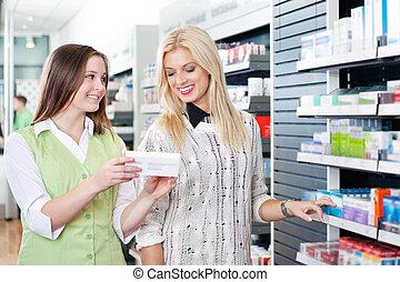 hembra, farmacéutico, aconsejar, cliente