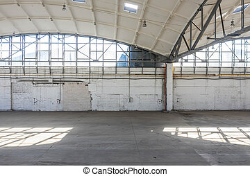 Wall of huge empty industrial warehouse. Modern interior. Unique soviet architecture. Basic structure. Hemispherical reinforced concrete load bearing roof.