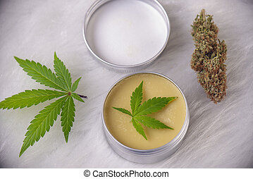 Hemp cream with marijuana leaves - cannabis topicals concept