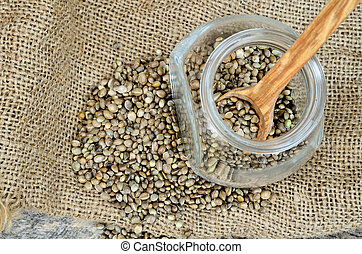 hemp seed in jar with spoon on sack