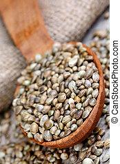 Hemp seeds in a wooden spoon