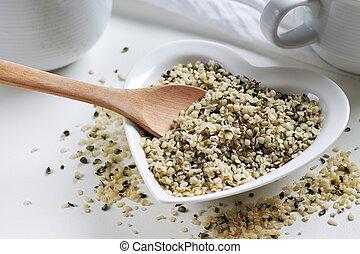 Hemp seeds in heart shaped bowl