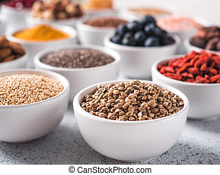 Hemp seeds in small white bowl and other superfood