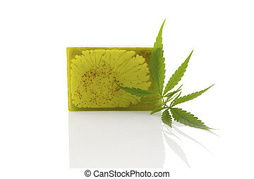 Hemp soap. - Green hemp soap and hemp leaf isolated on white...