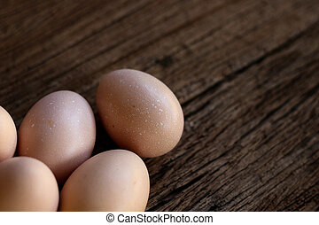 Hen eggs on wood background. Top View.