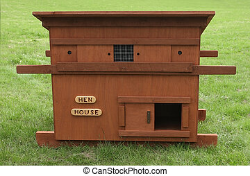 Hen House - Wooden chicken house standing on the grass.