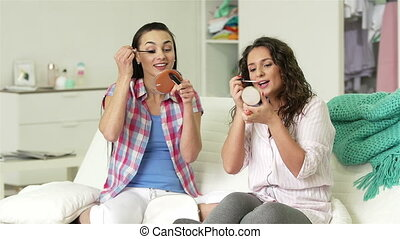 Hen Party - Girlfriends applying mascara and lip gloss