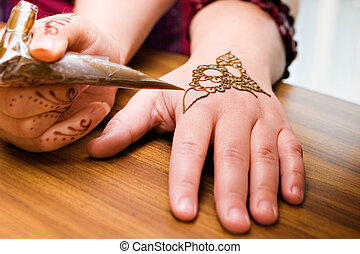 Henna Application - A young american woman gets henna...