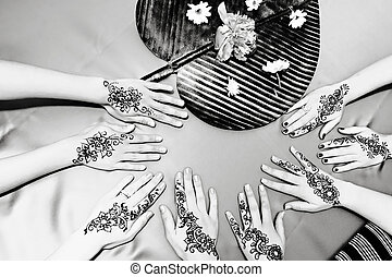 Henna Designs - Four pairs of hands with traditional henna...