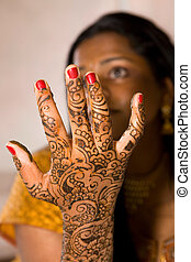 Henna Hand - A young Hindu Bride shows off her traditional...