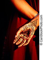 henna painting on hand