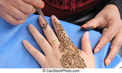 Henna Tattoo On Woman's Fingers - An Indian lady does a...