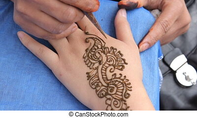 Henna Tattoo On Woman's Hand - An Indian lady does a henna...