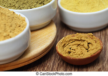 Henna uptan sandalwood powder on wooden surface