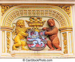 Heraldic lion and bear, town hall Coat of arms , the city arm of Bruges, Belgium, Europe.