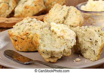 Herb Biscuits Closeup - Herb biscuits with butter on a plate