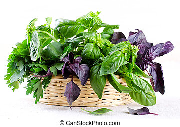Herb leaf selection in a rustic wooden basket