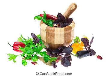Herb leaves of parsley, bay leaves and peppercorns, pepper in mortar