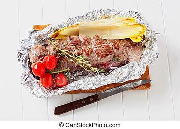Herb stuffed beef tenderloin in tinfoil