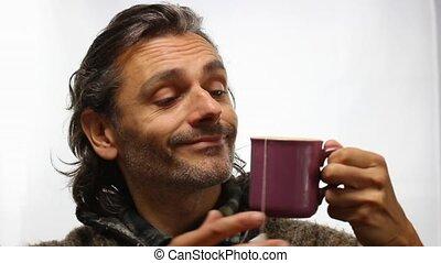 herb tea - man with hot mug of herb tea