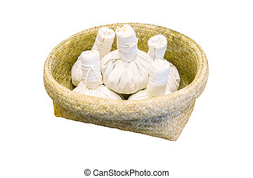 herbal compress for spa treatment in wicker baskets isolated white for background