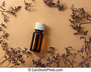 Herbal essential oil glass bottle mockup beige flower background Alternative medicine soothing relaxing spa aromatherapy