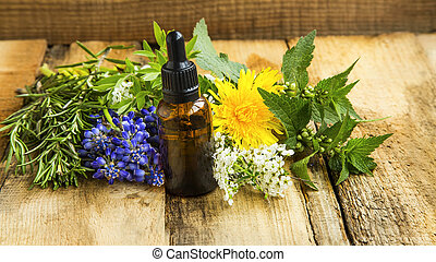 Herbal essential oil skincare bottle with plants and herbs, alternative medicine organic skincare